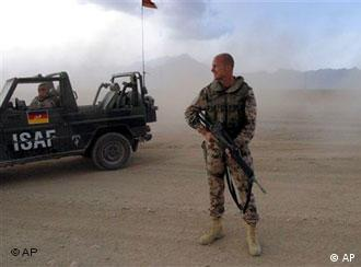 a German ISAF soldiers walks along during a patrol on the outskirts of Kabul,