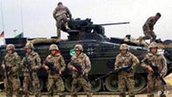 Bundeswehr soldiers in front of a tank in Afghanistan