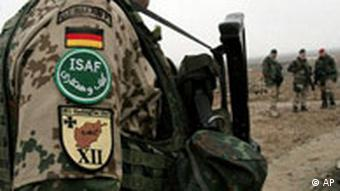 German soldiers, part of the International Security Assistance force (ISAF) stand guard during the opening ceremony of a German-funded medical center project in the Deh Sabz district of Kabul, Afghanistan
