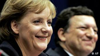 Merkel and Barroso smiling at an EU conference