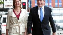Gordon Brown and wife Sarah arrive at Bridgewater Hall, Manchester, England, Sunday, June 24, 2007, for the special Labour leadership conference. Gordon Brown is finally to be crowned Labour leader Sunday - taking over from Tony Blair after a decade in wait. Brown, Britain's Treasury chief, first vied with Blair to lead the party in 1994 - but was persuaded to stand aside, sparking an often turbulent relationship between the men at the pinnacle of British politics for 10 years. (AP Photo/Martin Rickett/PA) ** UNITED KINGDOM OUT NO SALES NO ARCHIVES **