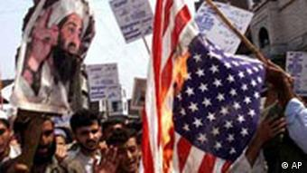 Protesters burn an American flag