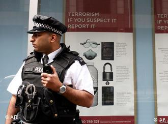 A police officer stands guard outside Scotland Yard