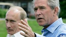 President Bush, right, accompanied by Russian President Vladimir Putin, gestures during their joint statements about their meetings, Monday, July 2, 2007, at the Bush family compound on Walker's Point in Kennebunkport, Maine. (AP Photo/Stephan Savoia)