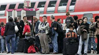 Passengers wait on a platform at Stuttgart central station