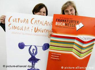Two yound women hold up posters announcing the Frankfurt book fair
