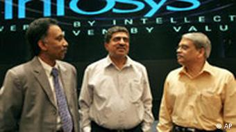 Former CEO of Infosys, Nandan M. Nilekani, center