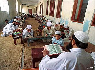 Pakistani children studying the Koran at a religious school in Lahore
