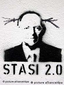 Graffiti showing Stasi 2.0 under a drawing of Schäuble