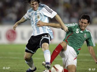 Argentina's Lionel Messi, left, fights for the ball with Mexico's Israel Castro