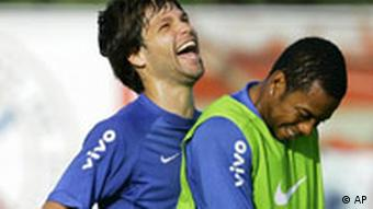 Brazil's soccer players Diego, left, and Robinho joke during a training session