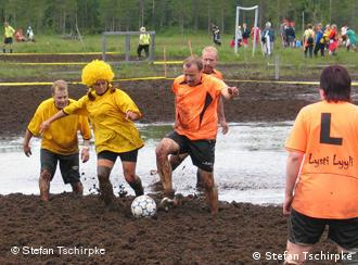 Players at the World Cup in swamp soccer in Finland