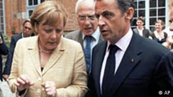 French President Nicolas Sarkozy, right, and German Chancellor Angela Merkel at Airbus plant in Toulouse.