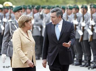 Merkel, left, received Brown with military honors in Berlin