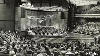 A black and white photo of a concert hall.