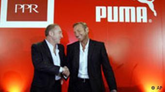 Francois-Henri Pinault, PPR-Vorstandschef und Puma-Vorstandschef Jochen Zeitz (AP Photo/Christof Stache)