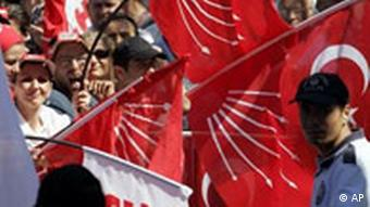 Supporters of the secular Republican People's Party or CHP wave party flags during an election rally in Sakarya, western Turkey, Thursday, July 19, 2007. The general elections in Turkey are scheduled to be held on July 22. (AP Photo/Murad Sezer)