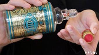 A person pours 4711 eau de cologne on their wrist