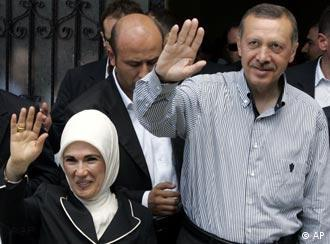 Premier Erdogan (right) and his wife on Sunday