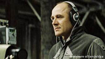 Actor Mühe listens in to a phone call in his part as a Stasi agent