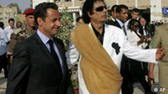 Libyan leader Moammar Gadhafi welcomes French President Nicolas Sarkozy at the Bab Azizia Palace in Tripoli Wednesday, July 25, 2007.