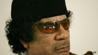 Libya's Moammar Gadhafi looks on during a debate on the sidelines of celebrations marking the 30-year anniversary of the declaration of the jamahiriya, or rule of the masses, in Sabha, Libya Friday, March 2, 2007. Gadhafi said in an unusual debate Friday it was time for his long-isolated nation to open up to the world and that one day it won't need him as leader. Still, he touted the ruling ideology he has entrenched here for three decades as superior to Western democracy. (AP Photo/Nasser Nasser)