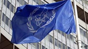 The flag of the International Atomic Energy Agency IAEA in front of the IAEA international center in Vienna