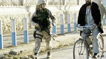An American soldier patrols the streets of Kabul