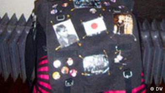 A typical bag with stickers and buttons of the Japanese flag and Japanese bands