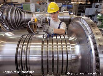 A Siemens factory employee working on a turbine in Görlitz, Germany