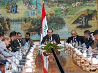 Iraqi Prime Minister Nouri al-Maliki, center, meets with local government officials in his office in Baghdad