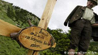 A Bavarian hiker stands by the crucifix marking Bruno's death
