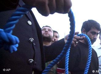An Iranian judiciary official prepares the rope to a hang murder convict