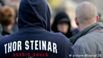 A man wearing a Thor Steinar hooded-top