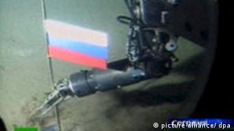 Submarine arm planting a Russian flag into the sea floor