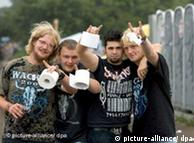Rock fans with toilet paper  at the Wacken Open Air Rock Festival