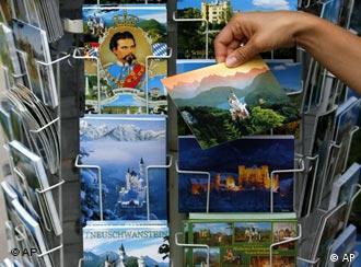 A tourist picking up one postcard among many