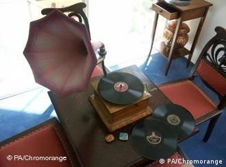 An old record player with records