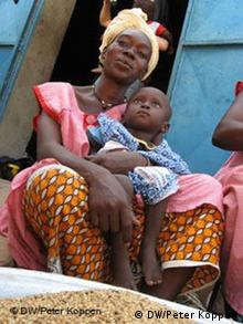Mali woman holding her child in her arms