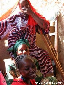 Three young African women laughing