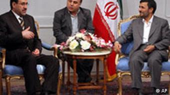 Iranian President Mahmoud Ahmadinejad, right, listens to Iraqi Prime Minister Nouri al-Maliki, during their meeting in Tehran on Wednesday Aug. 8, 2007.