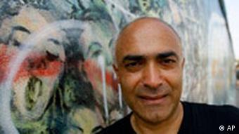 Alavi is pictured here at his East Side Gallery mural in Berlin (AP)