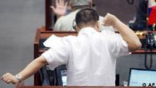 A trader stretches his arms as another trader talks on the phone during the first day of trading at the Philippine Stocks Exchange Monday Aug. 13, 2007 at the financial district of Makati city east of Manila, Philippines following Friday's slump of 3 percent in reaction to Wall Street's plunge and the subsequent slide in Asian markets. Philippine shares at the 30-company PSE Index ended slightly lower Monday at 14.93 points or 0.45 percent as investors quickly reaped profits after the market rose during the day's trading. (AP Photo/Bullit Marquez)