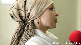 A teacher, Brigitte Weiss, wears a headscarf in a courtroom -- she converted to Islam a year ago.
