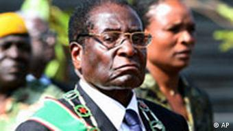 Zimbabwe President Robert Mugabe attends a commemoration of Heroes Day in Harare, Monday, Aug. 13, 2007. The Heroes and Defense Forces holidays Monday and Tuesday commemorate the seven-year bush war that ended white rule with independence in 1980. Acute gasoline shortages crippled transport services, stranding thousands of travelers at bus stops across Zimbabwe before a two-day holiday honoring guerrillas who fought against colonial-era white rule. (AP Photo)