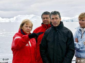 Merkel with her environment minister, Denmark's premier, and the Danish enivornment minister in Greenland