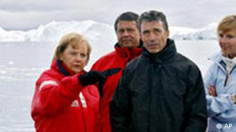 German chancellor Angela Merkel in Greenland with Danish energy minister Connie Hedegaard, Denmark's premier Fogh Rasmussen and German enivronmental minister Sigmar Gabriel