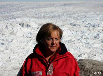 German Chancellor Angela Merkel poses in front of the Eqi glacier near Ilulissat, Greenland