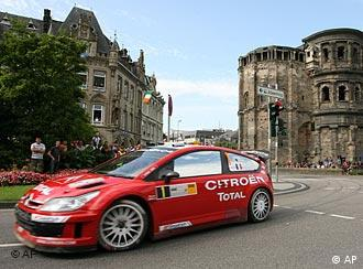 Loeb's red car in the centre of historic Trier