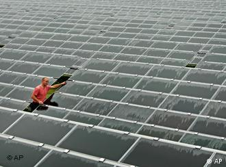 A worker checks solar panels